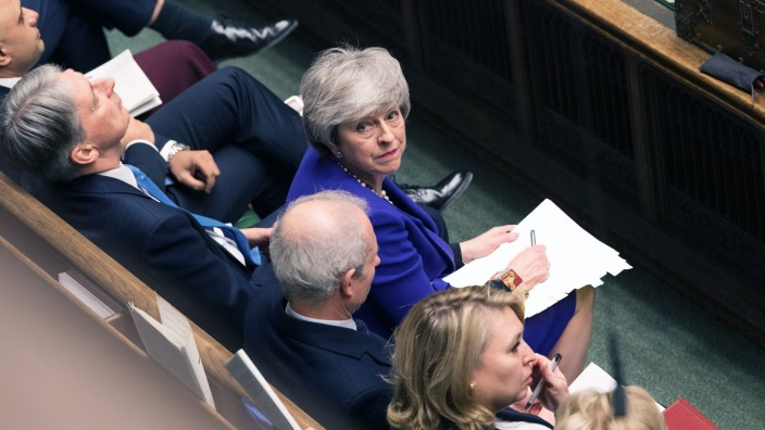 Britain's Prime Minister Theresa May looks up during PMQ session in Parliament, in London