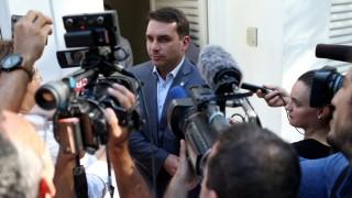 FILE PHOTO: Flavio Bolsonaro, son of Brazil's President Jair Bolsonaro, speaks with journalists as he arrives to record an electoral program for television in Rio de Janeiro