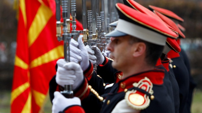 Members of the Macedonian honour guard line up before the welcoming ceremony in Skopje