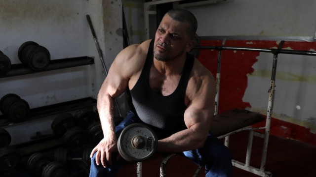 Ibrahim al-Masri, trains at a gym, on his last day as the chief muezzin of the Al-Jazzar Mosque, in Acre