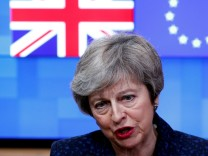 FILE PHOTO: British PM May speaks to the press at the European Council headquarters in Brussels