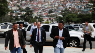 Venezuelan opposition leader Juan Guaido arrives to attend a meeting with representatives of FEDEAGRO, the Confederation of Associations of Agricultural Producers of Venezuela, in Caracas