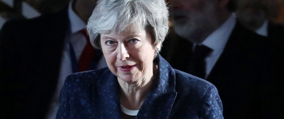 British PM May leaves EU parliament in Brussels
