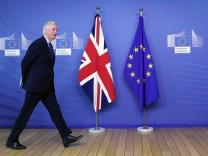 EU Chief Brexit Negotiator Barnier walks at EC HQ in Brussels