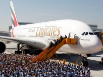 FILE PHOTO: Airbus CEO Enders Emirates Airlines Group CEO Sheikh Ahmed bin Saeed al-Maktoum and EADS CEO Gallois disembark from A380 aircraft during a handover ceremony in Hamburg