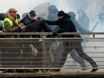 FILE PHOTO: Former French boxing champion, Christophe Dettinger is seen during clashes with French Gendarmes as part of a demonstration by the 'yellow vests' on the passerelle Leopold-Sedar-Senghor bridge in Paris