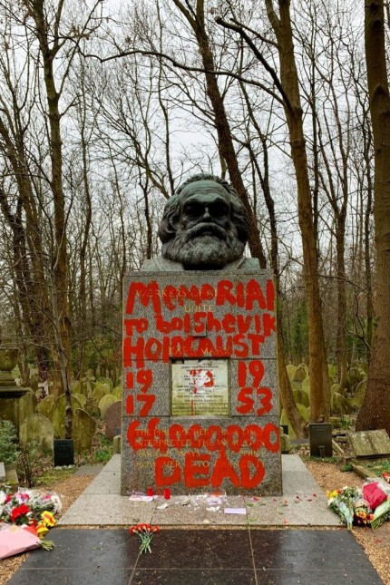 Philosopher Marx's grave site is seen vandalised with red paint in London