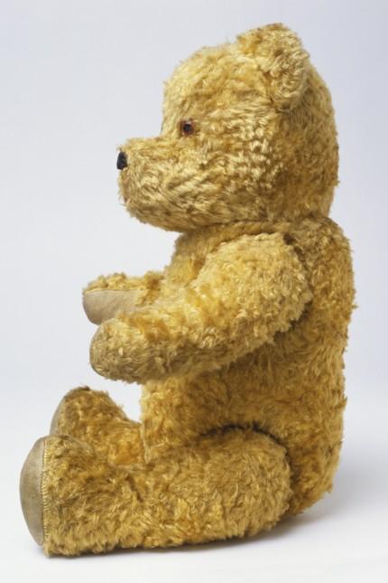 Sitting 1960s cotton plush teddy bear, side view