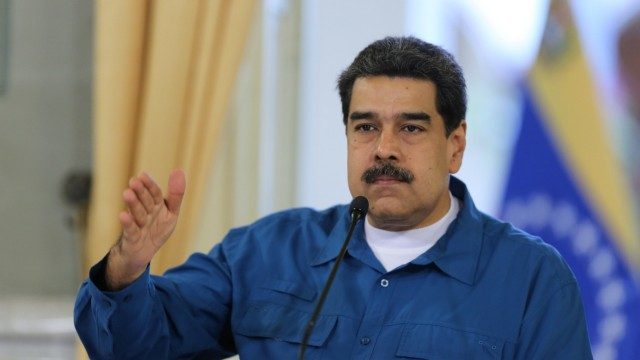 Venezuela's President Nicolas Maduro gestures while he speaks during a meeting with members of the government in Caracas