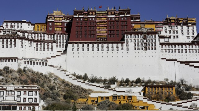 File photo of paramilitary policeman stands guard in front of the Potala Palace in Lhasa, Tibet Autonomous Region