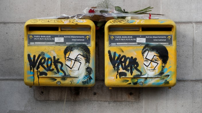 Vandalized mailboxes with swastikas covering portraits of the late Holocaust survivor and renowned French politician Simone Veil are seen before renovation in Paris