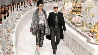 FILE PHOTO: British model Stella Tennant walks with designer Karl Lagerfeld during the Metiers D'Art Show for Chanel fashion house in Paris