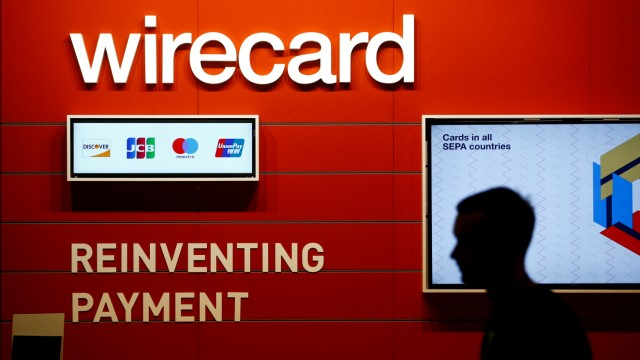 FILE PHOTO: A man walks past the Wirecard booth at the computer games fair Gamescom in Cologne, Germany, August 22, 2018.