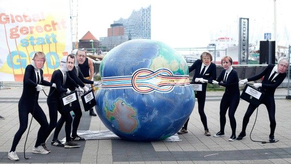 Activists from ATTAC organisation take part in a demonstration in front of Elbphilharmonie against the upcoming G20 summit in Hamburg