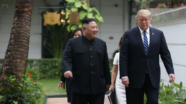 North Korea's leader Kim Jong Un and U.S. President Donald Trump interact in the garden of the Metropole hotel during the second North Korea-U.S. summit in Hanoi