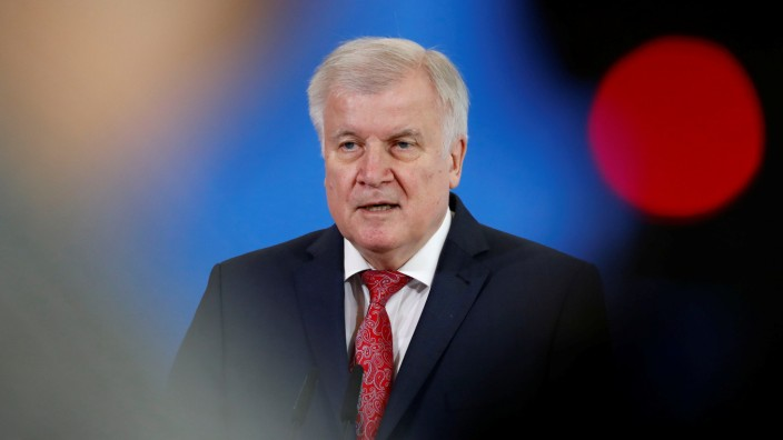 German Interior Minister Seehofer addresses a news conference in Berlin