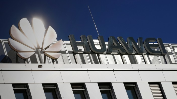FILE PHOTO - The logo of China's Huawei Technologies shines in the bright sun over the headquarters of the telecommunications giant in Duesseldorf