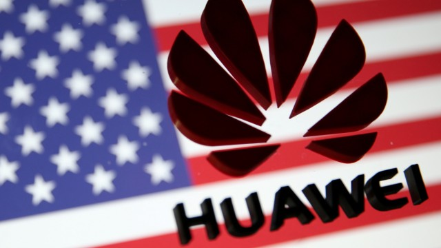 FILE PHOTO - A 3D printed Huawei logo is placed on glass above a displayed U.S. flag in this illustration