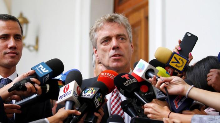 German ambassador to Venezuela Daniel Martin Kriener delivers a news conference next to Venezuelan opposition leader Juan Guaido and accredited diplomatic representatives of the European Union in Caracas