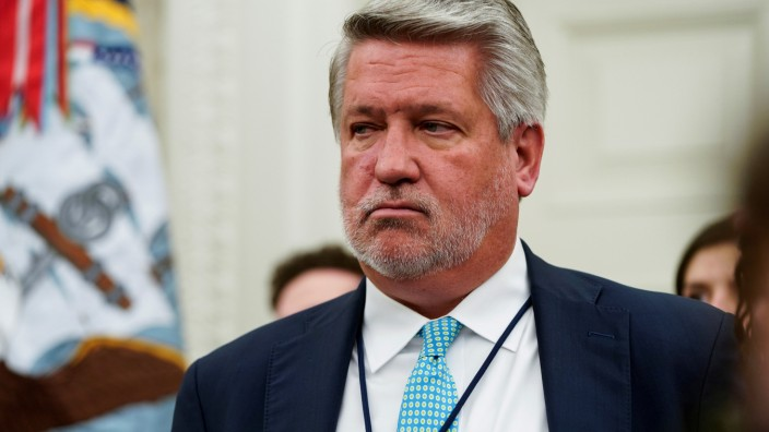 FILE PHOTO: White House Communications Director Bill Shine watches as U.S. President Donald Trump participates in a signing ceremony for S. 756, âÄoFirst Step Actâĝ and H.R. 6964, âÄoJuvenile Justice Reform Actâĝ at the White House in Washington