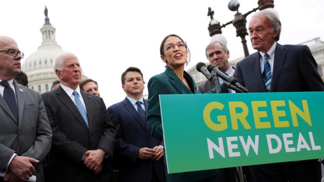 FILE PHOTO: U.S. Representative Ocasio-Cortez and Senator Markey hold a news conference for their proposed 'Green New Deal' at the U.S. Capitol in Washington