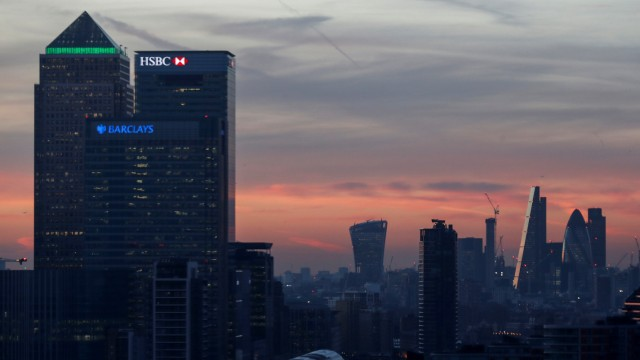 FILE PHOTO: Canary Wharf and the city are seen at sunset in London