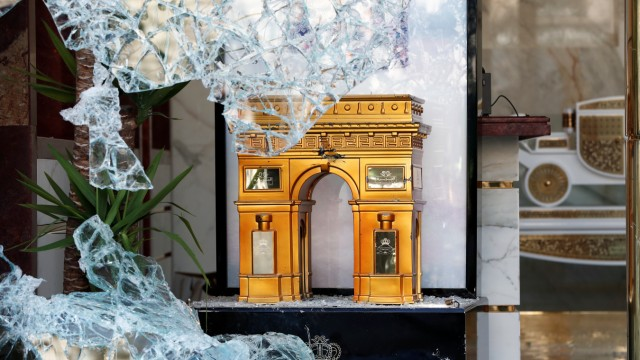 A miniature Arc de Triomphe is seen in a broken store window on the Champs-Elysees during a demonstration by the 'yellow vests' movement in Paris