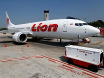 FILE PHOTO: Lion Air's Boeing 737 Max 8 airplane is parked on the tarmac of Soekarno Hatta International airport near Jakarta