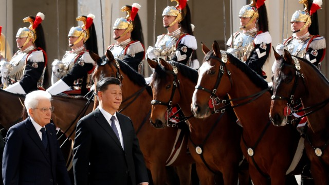 Chinese President Xi Jinping and Italian President Sergio Mattarella inspect an honour guard at the Quirinal Palace in Rome