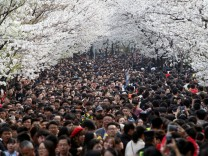 Visitors flock onto a street near Jiming Temple in Nanjing