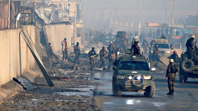 FILE PHOTO: Afghan security forces inspect the site of a car bomb blast at green village in Kabul, Afghanistan