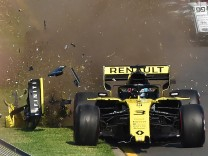 Renault's Daniel Ricciardo crashes at the start of the Formula One F1 Australian Grand Prix at the Albert Park Grand Prix Circuit in Melbourne