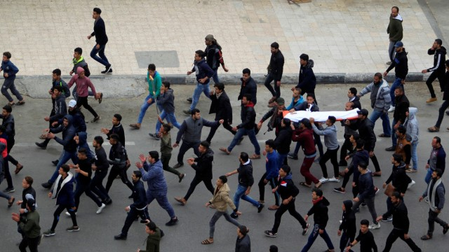 Mourners carry the body of Palestinian Mohamad Sa'ad, who was killed at the Israel-Gaza border, during his funeral in Gaza City