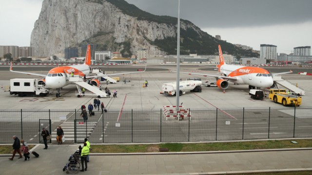 Passengers disembark an EasyJet flight at Gibraltar International airport, in front of the Rock, near the border with Spain in the British overseas territory of Gibraltar