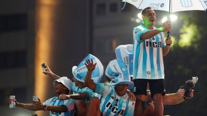 Racing Club players and fans celebrate the Superliga title in Buenos Aires