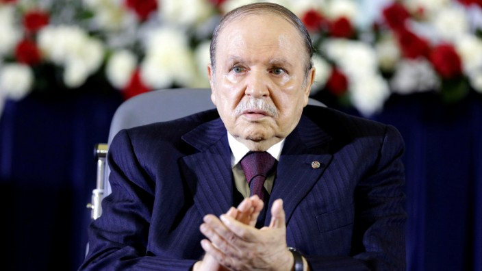 FILE PHOTO: President Abdelaziz Bouteflika claps during a swearing-in ceremony in Algiers