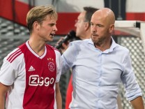 L R Frenkie de Jong of Ajax coach Erik ten Hag of Ajax during the UEFA Champions League third rou; Ten Hag de Jong
