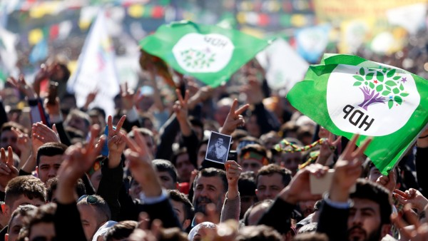 People wave pro-Kurdish Peoples' Democratic Party (HDP) flags during a gathering to celebrate Newroz, which marks the arrival of spring and the new year, in Istanbul