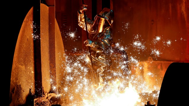 FILE PHOTO: A steel worker of Germany's ThyssenKrupp AG takes a sample of raw iron from a blast furnace in Duisburg