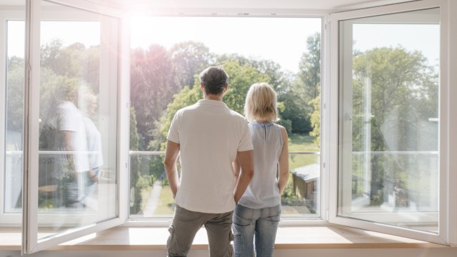 Mature couple looking out of window into the sun model released Symbolfoto property released PUBLICA