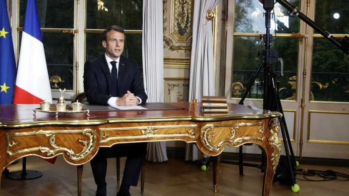 French President Emmanuel Macron addresses the French nation following a massive fire at Notre Dame Cathedral, at the Elysee Palace in Paris