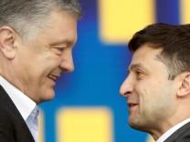 Ukraine's presidential candidates Petro Poroshenko and Volodymyr Zelenskiy attend a debate in Kiev