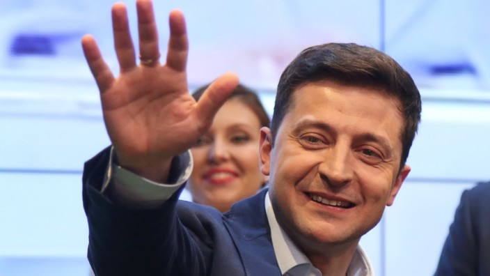Candidate Zelenskiy waves to supporters following the announcement of an exit poll in Ukraine's presidential election in Kiev