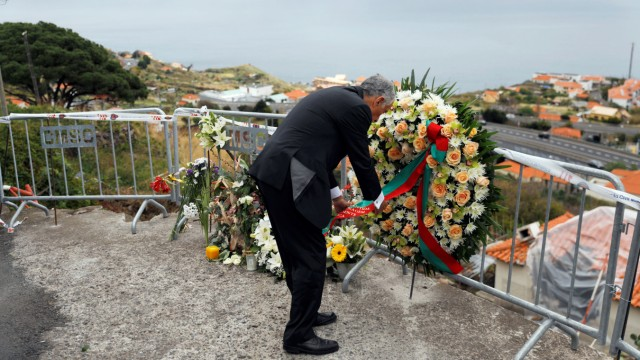 Portugal's President Marcelo Rebelo de Sousa visits the site of a bus accident in Canico
