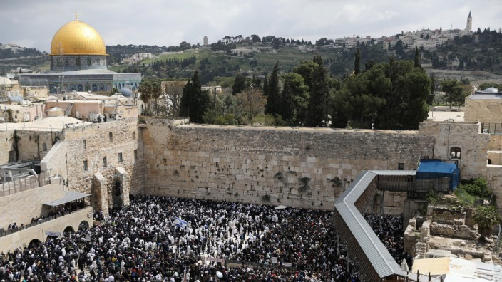 The Dome of the Rock is seen in the background as Jewish worshippers take part in a priestly blessing during the Jewish holiday of Passover at the Western Wall, Judaism's holiest prayer site, in Jerusalem's Old City