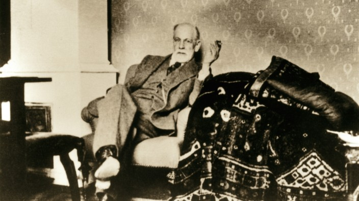 Sigmund Freud (1856-1939), Austrian neurologist and psychiatrist who founded the psychoanalytic school of psychology. In his summer residence near his analytic couch. Ca. 1930.