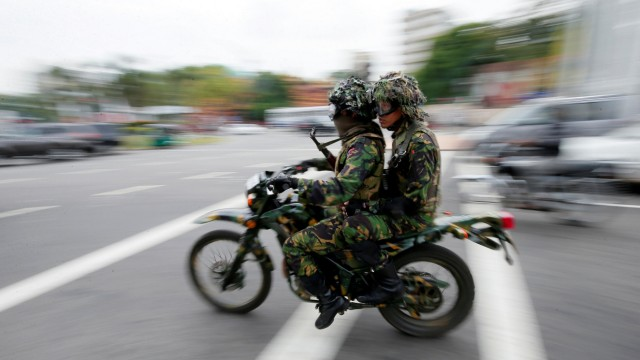Sri Lankan Special Task Force soldiers are seen on patrol near a mosque during the Friday prayers, in Colombo