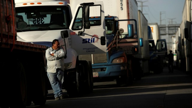 A man is seen outside his truck as he waits in a long queue for border customs control to cross into the U.S., at the Zaragoza-Ysleta border crossing bridge in Ciudad Juarez