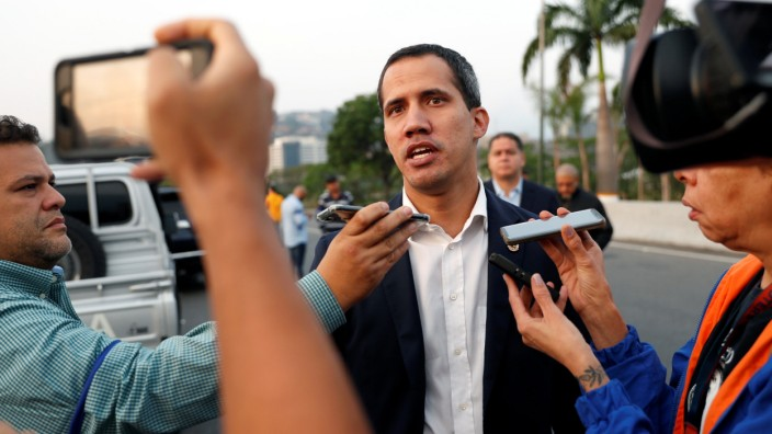 Venezuelan opposition leader Juan Guaido talks to the media outside Generalisimo Francisco de Miranda Airbase in Caracas
