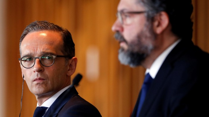 German Foreign Minister Heiko Maas looks on near Brazil's Foreign Minister Ernesto Araujo during a news conference at the Itamaraty Palace in Brasilia